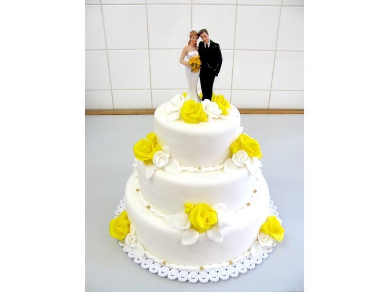 bíložlutý dort s figurkou